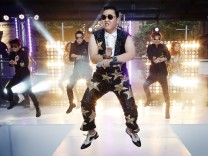 File photo of South Korean singer Psy performing his hit 'Gangnam Style' during a morning television appearance in Sydney