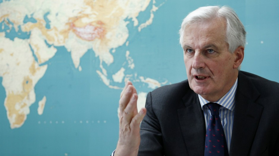 EU Commissioner Barnier answers reporters' questions during an interview with Reuters in Brussels