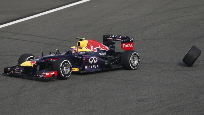 Red Bull Formula One driver Mark Webber of Australia loses his rear wheel during the Chinese F1 Grand Prix at the Shanghai International Circuit