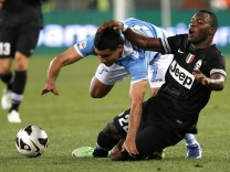 Juventus' Asamoah challenges Lazio's Ederson during their Italian Serie A soccer match in Rome