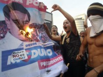 Venezuela, Plakat von Nicolas Maduro, Proteste