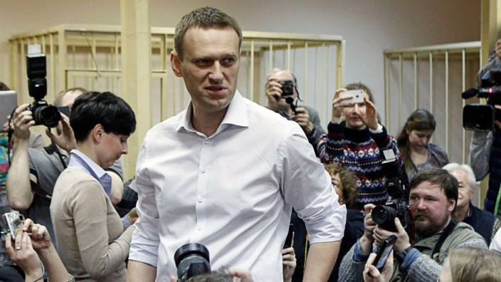 Russian opposition leader and anti-graft blogger Navalny looks on after arriving for a court hearing in Kirov