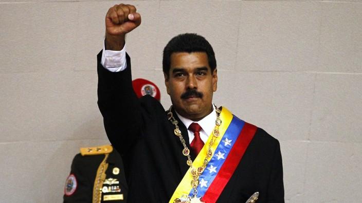 Venezuela's President Nicolas Maduro gestures after being sworn into office in Caracas