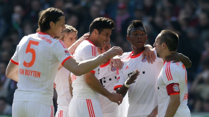 Bayern Munich's Ribery and team mates celebrate after scoring during their German Bundesliga first division soccer match against Hannover 96 in Hanover