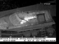 Handout of an aerial infrared image showing the outline of Dzhokhar Tsarnaev in a boat