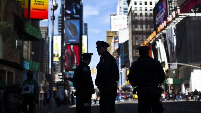 New York Police officers keep watch on tourists at Times Square in New York