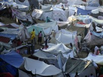 A view of a makeshift refugee camp, where at least 50,000 people are staying, on the golf course of the Petion Club in Port-au-Prince