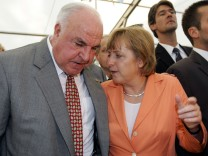 File photo of Merkel talking to former German Chancellor Kohl during a wine party in Bavarian town of Castell