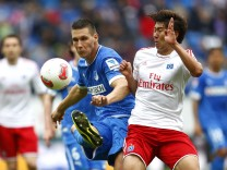 Hoffenheim's Suele challenges Hamburger SV's Heung Min Son during their German first division Bundesliga soccer match in Sinsheim