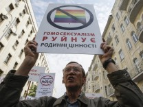 A man attends an anti-gay rally in Kiev