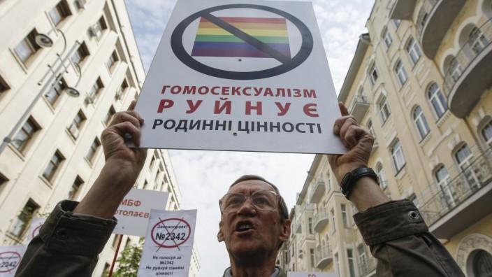 A man attends an anti-gay rally in Kiev