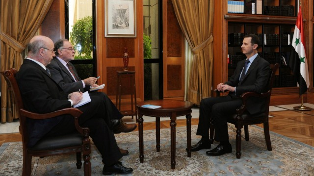Syria's al-Assad says chemical weapons claims a prelude to war