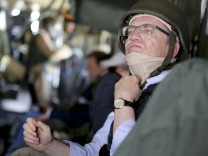 German Defence Minister Thomas de Maiziere sits in a German army Bundeswehr CH53 helicopter en route from Kunduz to Mazar-i-Sharif