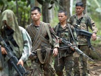 Elite Filipino soldiers  patrol in Jolo island