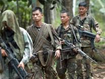 Elite Filipino soldiers  patrol in Jolo island