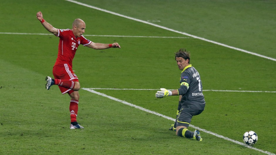 Bayern Munich's Arjen Robben shoots to score past Borussia Dortmund's goalkeeper Roman Weidenfeller during their Champions League Final soccer match at Wembley Stadium in London