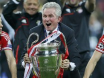Bayern Munich's coach Heynckes celebrates with the trophy after winning Champions League final soccer match against Borussia Dortmund in London