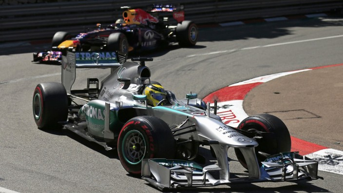 Mercedes Formula One driver Rosberg of Germany steers his car ahead of compatriot Red Bull Formula One driver Vettel during the Monaco F1 Grand Prix