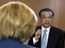German Chancellor Merkel and Chinese Premier Li chat before bilateral talks in Berlin