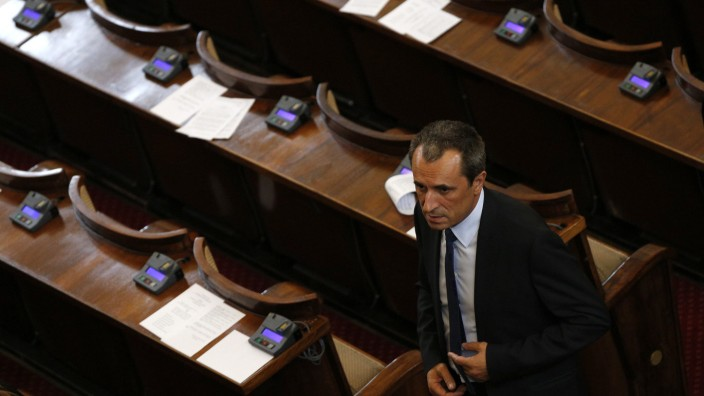 Bulgarian newly-elected Prime Minister Oresharski walks at the end of a session in the parliament in Sofia
