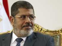 Egypt's President Mursi attends a meeting with Palestinian President Abbas at El-Thadiya presidential palace in Cairo