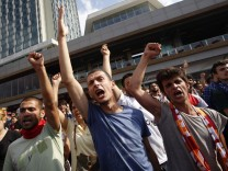 Demonstrators shout slogans during an anti-government protest at Taksim Square in central Istanbul