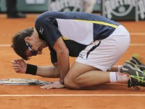 Robredo of Spain celebrates defeating compatriot Almagro in their men's singles match at the French Open tennis tournament in Paris