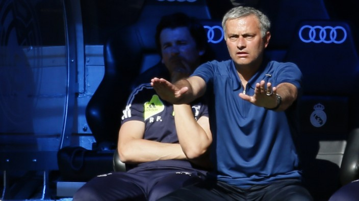 Real Madrid coach Jose Mourinho reacts during their Spanish first division soccer match against Osasuna at Santiago Bernabeu stadium in Madrid