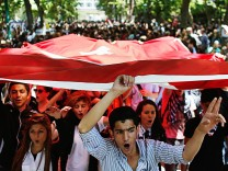Protesters carry the Turkish flag and shout anti-government slogans during a demonstration at Gezi Park near Taksim Square in central Istanbul