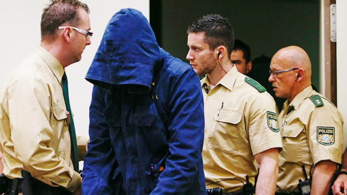 Defendant Carsten S. arrives for his trial in a courtroom in Munich
