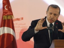 Turkish Prime Minister Recep Tayyip Erdogan  speaks during a news conference in Tunis