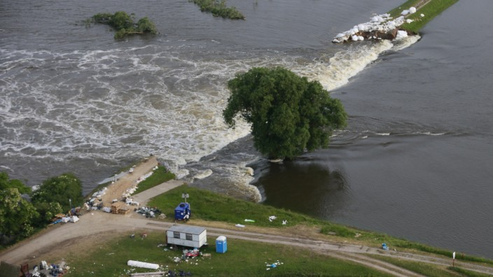 Picture shows broken dam built to contain swollen Elbe river during floods near village of Fischbeck