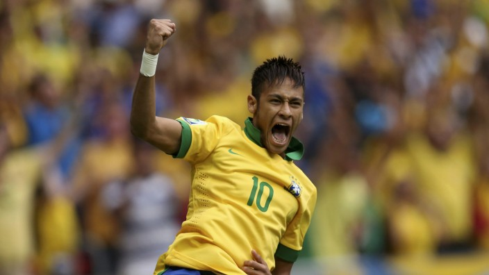 Brazil's Neymar celebrates scoring a goal during their Confederations Cup Group A soccer match against Japan at Estadio Nacional in Brasilia
