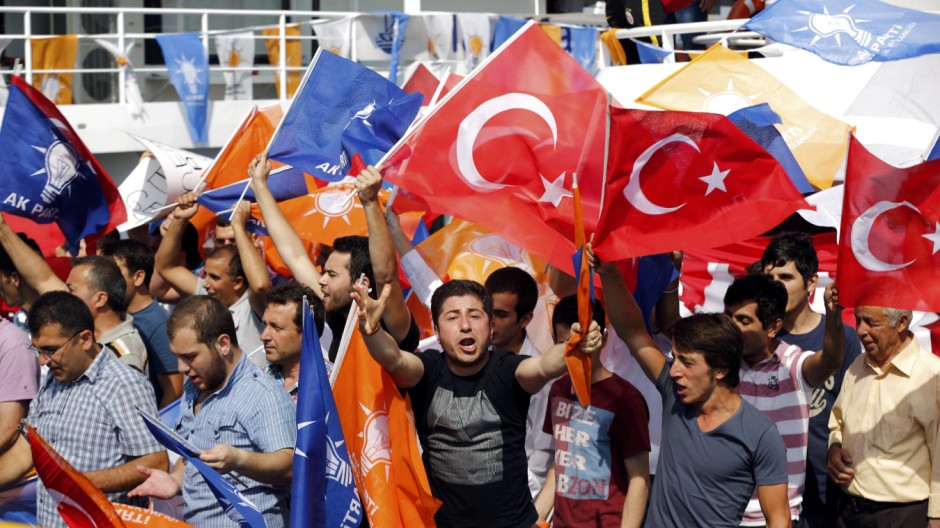 Supporters of PM Erdogan's ruling AK party arrive by boat for a rally in Istanbul