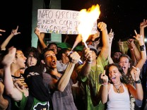 Demonstrators protest against the Confederation's Cup and the government of Brazil's President Dilma Rousseff outside the national congress in Brasilia