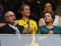 FIFA President Blatter speaks next to Brazil's President Rousseff before the Confederations Cup Group A soccer match at Estadio Nacional in Brasilia