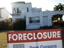 A foreclosure sale sign sits in front of a house in Miami Beach