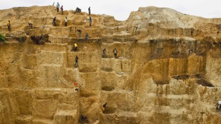 Labourers work at a mine believed to contain gold in Minna