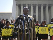 White speaks to reporters after the U.S. Supreme Court struck down part of a federal law designed to protect minority voters, at the court's building in Washington