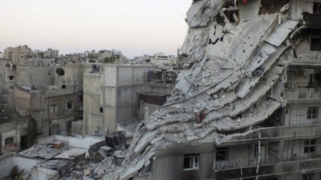A general view shows damaged buildings in the Al-Khalidiya neighbourhood of Homs