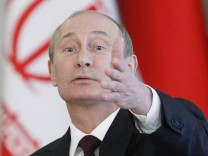 Russia's President Putin attends a news conference, part of the Gas Exporting Countries Forum, at the Kremlin in Moscow