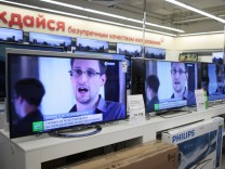 Television screens show former U.S. spy agency contractor Snowden, at an electronics store in Moscow