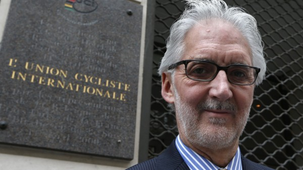British Cycling President Brian Cookson poses in front of the building where the International Cycling Union was founded in Paris