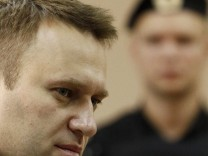 Russian opposition leader and anti-corruption blogger Alexei Navalny attends a court hearing in Kirov