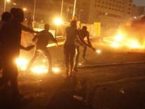 Protesters, who are against former Egyptian President Mohamed Mursi, demonstrate near pro-Mursi supporters, near Tahrir Square in Cairo
