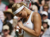 Sabine Lisicki of Germany reacts during her women's singles final tennis match against Marion Bartoli of France at the Wimbledon Tennis Championships, in London