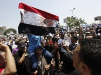 Members of the Muslim Brotherhood and supporters of deposed Egyptian President Mohamed Mursi shout slogans at Republican Guard headquarters in Nasr City
