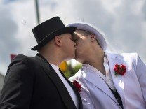 Two men kiss during the Christopher Street Day (CSD) parade in Berlin