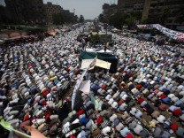 Supporters of ousted President Mohamed Mursi perform the weekly Friday prayers at Rabaa Adawiya square in Cairo