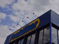 Clouds are pictured above the entrance of German do-it-yourself retailer Praktiker in Munich